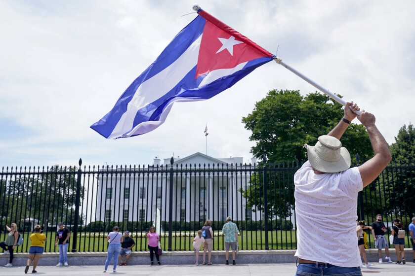 People participate in a rally outside the White House on Tuesday in support of the protesters in Cuba.