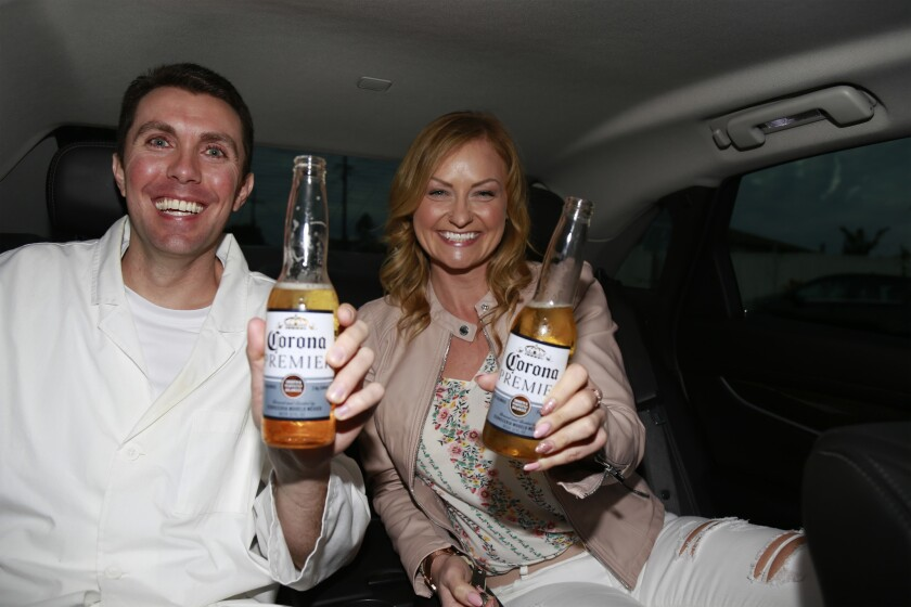 Katrina and Ian enjoying a couple of Corona Premier beers on their way to dinner.