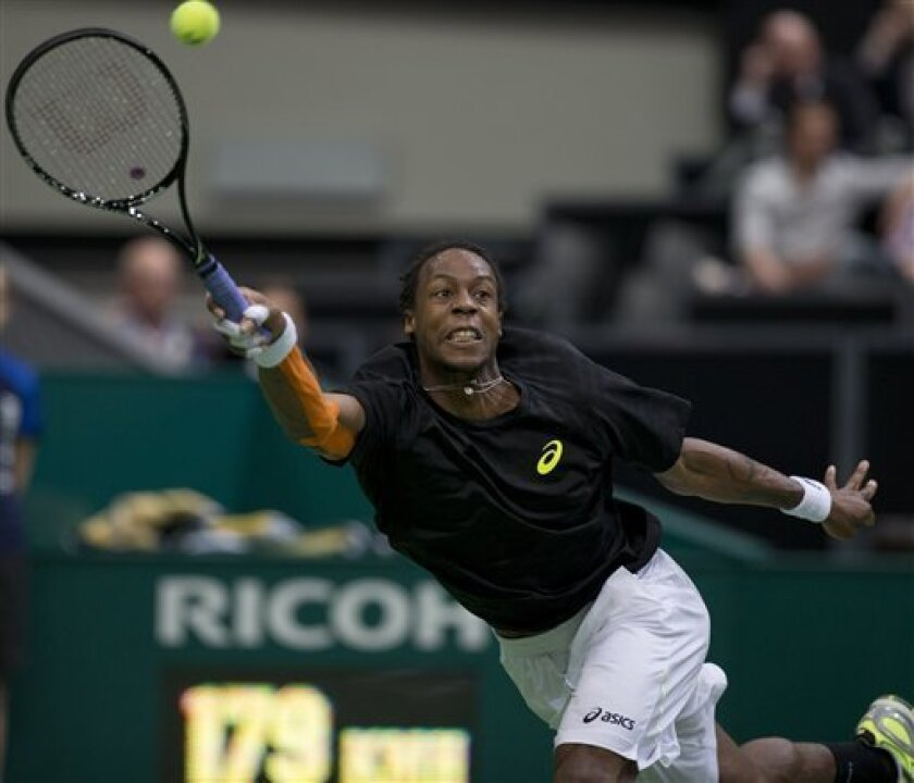 Gael Monfils of France returns a shot against  Juan Martin del Potro of Argentina at the ABN AMRO world tennis tournament at Ahoy Arena in Rotterdam, Netherlands, Tuesday Feb. 12, 2013. (AP Photo/Peter Dejong)
