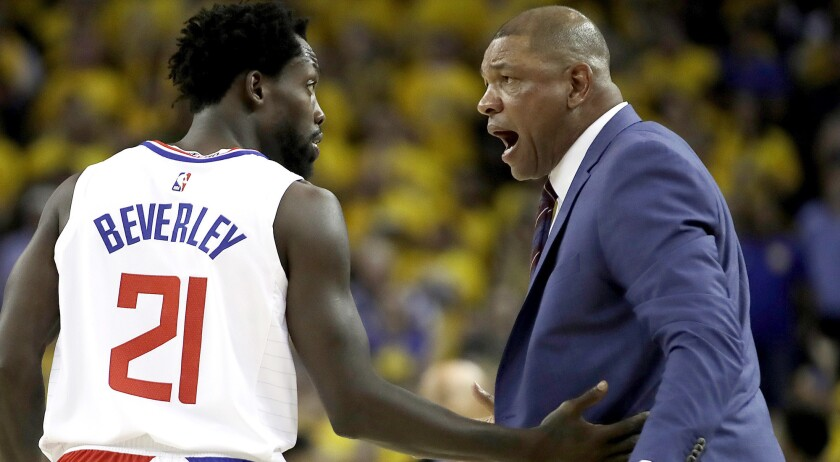Veteran Patrick Beverley was called the heartbeat of a gritty Clippers team by coach Doc Rivers, right.