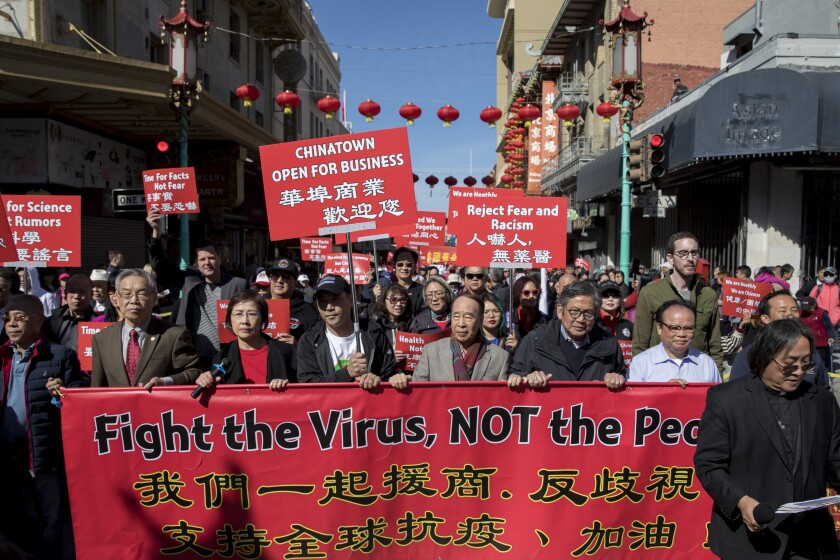 Hundreds of Chinatown residents along with local and state officials protest racism against the Chinese community during a march in San Francisco on Feb. 29.