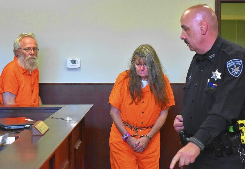 Bruce and Deborah Leonard enter court for their arraignment in New Hartford, N.Y. They are charged with manslaughter in the beating death of their 19-year-old son. Four others linked to their church also face charges.