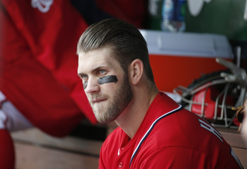 Bryce Harper sits in the dugout during a game between the Washington Nationals and St. Louis Cardinals.