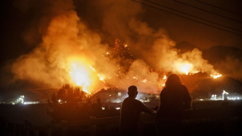 TEMESCAL VALLEY, CALIF. -- FRIDAY, AUGUST 10, 2018: People watch flames as the Holy Fire rages on a