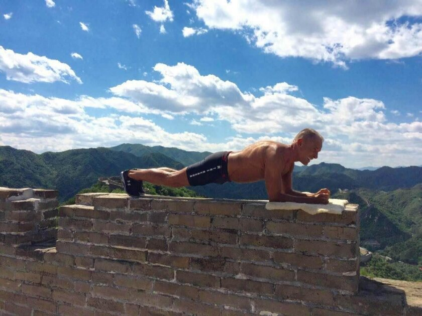 Carlsbad endurance athlete George Hood practices his planking technique on the Great Wall of China. Hood took second place in the World Cup Plank Challenge in Beijing on Saturday.