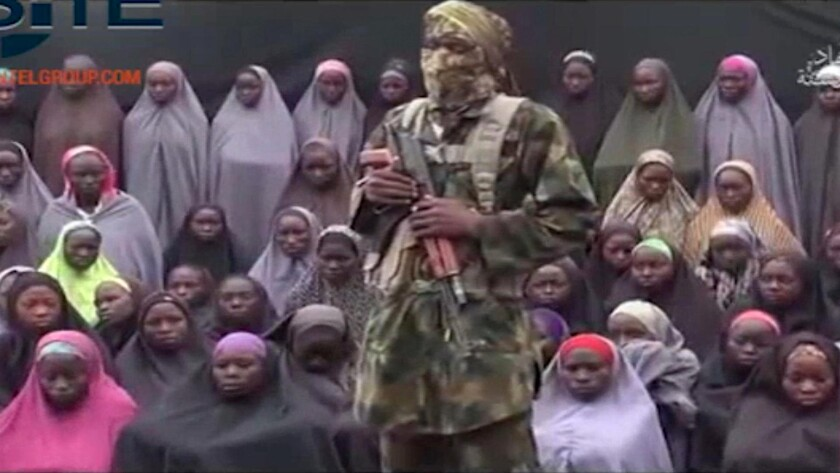 A video released on Sunday shows a Boko Haram soldier standing in front of a group purported to include some of the 276 schoolgirls abducted in April 2014 from Chibok, Nigeria.