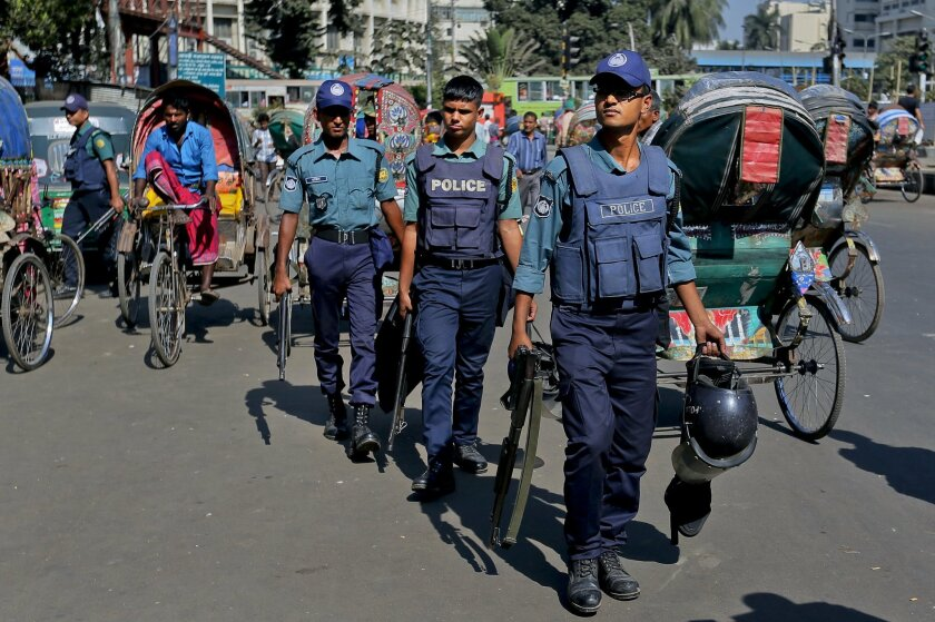 Bangladeshi policemen patrol through the streets during a nationwide strike called by the main Islamist party, Jamaat-e-Islami in Dhaka, Bangladesh, Monday, Nov. 23, 2015. Bangladesh was on high alert Monday after executing two opposition leaders for war crimes during the country's 1971 independence war, despite threats of violence by their supporters and international concerns that the legal proceedings were flawed.(AP Photo)