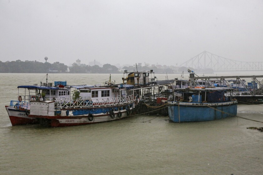 Mechanized boats and ferries stand moored at an empty jetty as ferry services were suspended due to cyclonic storm, on the Hooghly River in Kolkata, India, Saturday, Nov. 9, 2019. Authorities in nearby Bangladesh put more than 50,000 volunteers on standby and readied about 5000 shelters as a strong cyclone in the Bay of Bengal is expected to hit the low-lying nation's vast southwestern and southern coast on Saturday evening. (AP Photo/Bikas Das)
