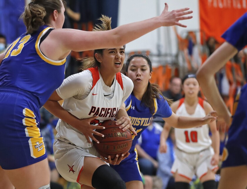 Annika Jiwani drives to the basket in the CIF Southern Section Division 5A girls' basketball championship.