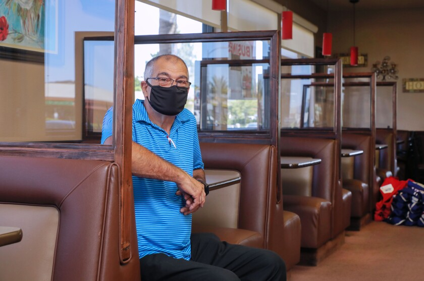 J&M Family Restaurant owner Joe Goncalves sits in a booth.