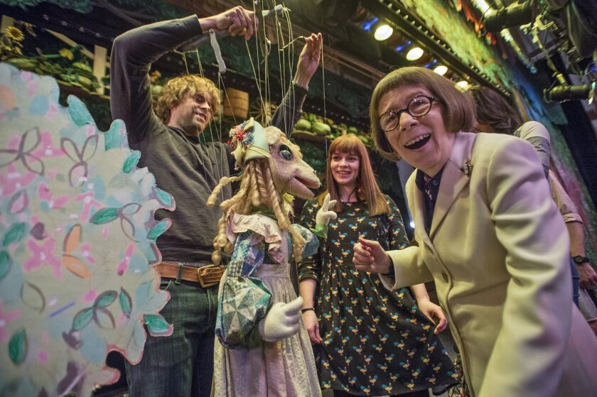 """Actors Eric Christian Olsen, left, Renee Felice Smith and Linda Hunt at the Bob Baker Marionette Theater during a shoot for """"NCIS: Los Angeles."""" The episode featuring the puppet theater airs Monday night."""