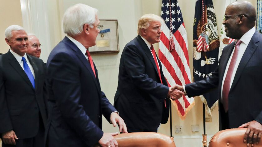 President Trump greets Bernard J. Tyson, right, CEO of Kaiser Permanente, and Joseph R. Swedish, CEO of Anthem, during a Feb. 27 meeting with health insurance executives. Also attending were Vice President Mike Pence and Health and Human Services Secretary Tom Price.