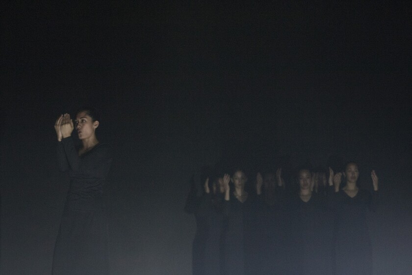 """Cast members from """"Stone in Her Mouth"""" attend a dress rehearsal at the Palace Theatre in Los Angeles on September 26, 2013. The piece is a ritualistic dance and theater piece choreographed by Lemi Ponifasio and his company, MAU."""