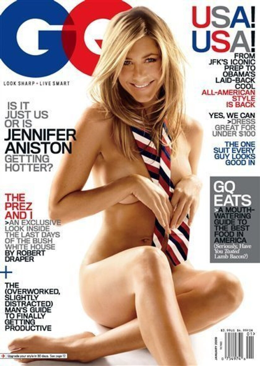 """This image provided by GQ magazine shows actress Jennifer Aniston on the cover of the magazine's January 2009 issue. Aniston wears a tie _ and nothing else _ on the January cover of GQ magazine. The 39-year-old actress strips down and shows off her toned and tanned body next to the headline """"Is it just us or is Jennifer Aniston getting hotter?"""" (AP Photo/GQ)"""