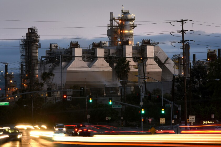 Cars drive by the Torrance refinery in 2016.
