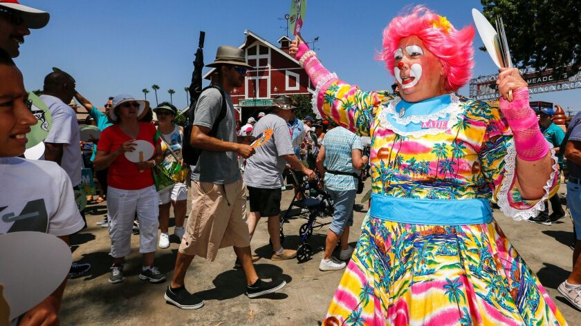Katie the clown welcomes visitors to the opening day of the O.C. Fair in Costa Mesa.