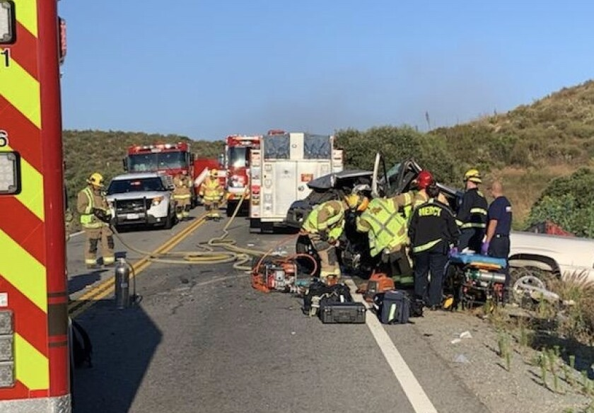 Cal Fire crews work to treat patients injured in a head-on collision in Dulzura Saturday.