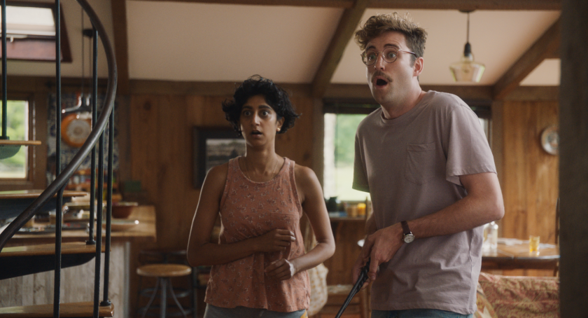 """Sunita Mani and John Reynolds in the movie """"Save Yourselves!"""""""
