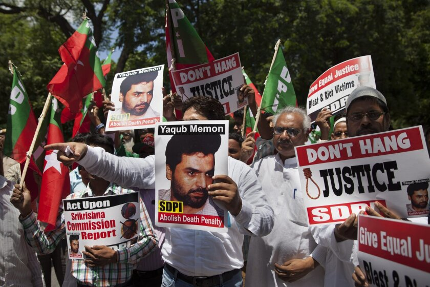 In this July 27, 2015, photo, activists of the Social Democratic Party of India carry placards with portraits of Yakub Abdul Razak Memon, convicted in the 1993 Mumbai bombings, during a protest against his death sentence outside Maharashtra House in New Delhi, India. Jailed for more than two decades over his role in the 1993 Mumbai bombings that killed 257 people, he has made many appeals and is scheduled to be hanged Thursday, July 30, 2015. (AP Photo/Tsering Topgyal)