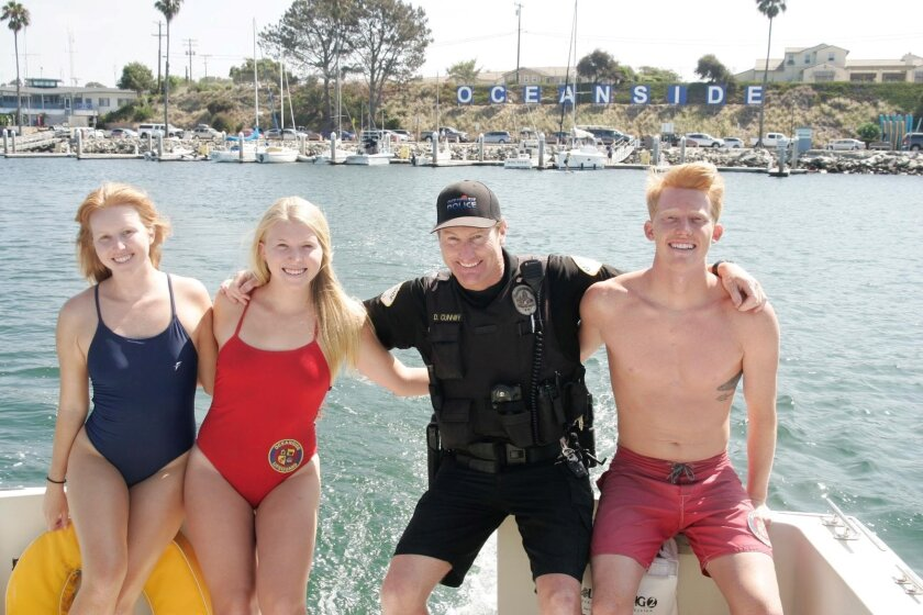 Oceanside Harbor Police Officer David Cunniff, second from right, and his lifeguard children Austin, Ireland and Arielle. Photo courtesy of Joel Mayer