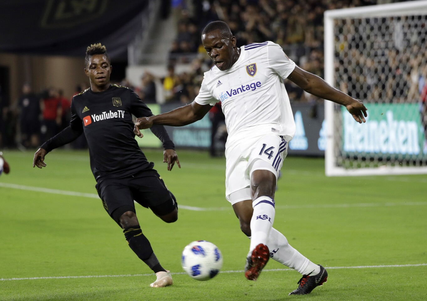 Real Salt Lake's Nedum Onuoha, right, clears the ball as Los Angeles FC's Latif Blessing closes in during the first half of an MLS soccer playoff match Thursday, Nov. 1, 2018, in Los Angeles. (AP Photo/Marcio Jose Sanchez)