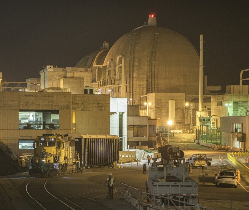 Trucks, heavy equipment and workers at the San Onofre Nuclear Generating Station during dismantling.