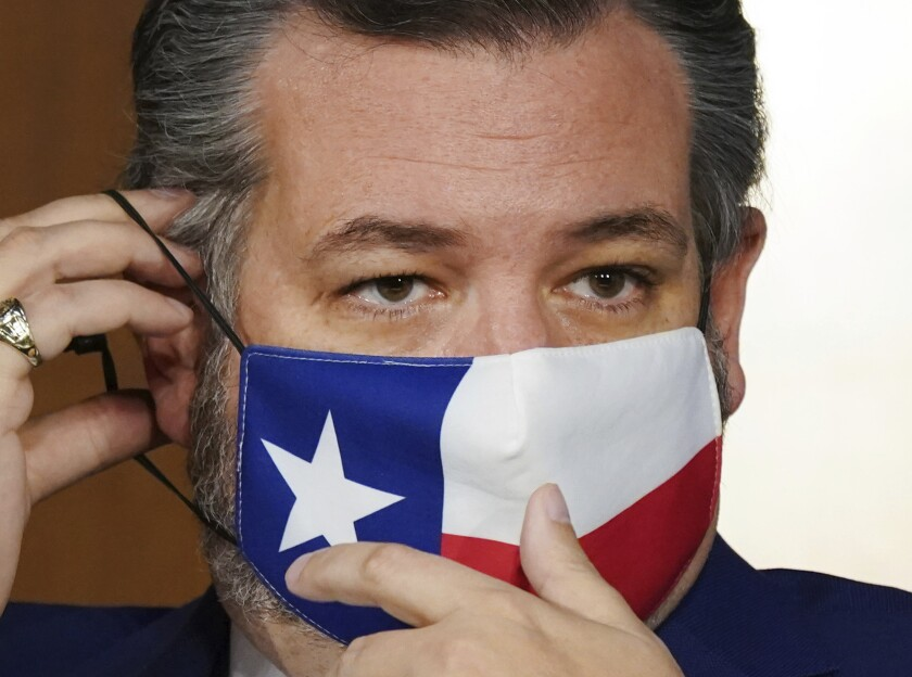 Sen. Ted Cruz in a face mask with a Texas flag design.