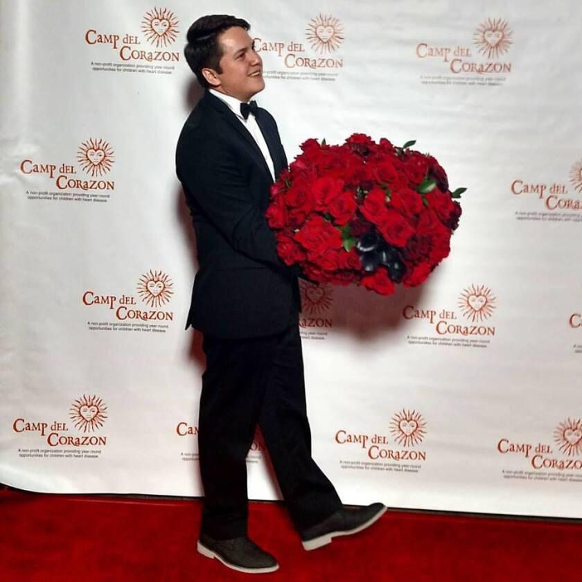 Joey Toczylowski with roses.jpg
