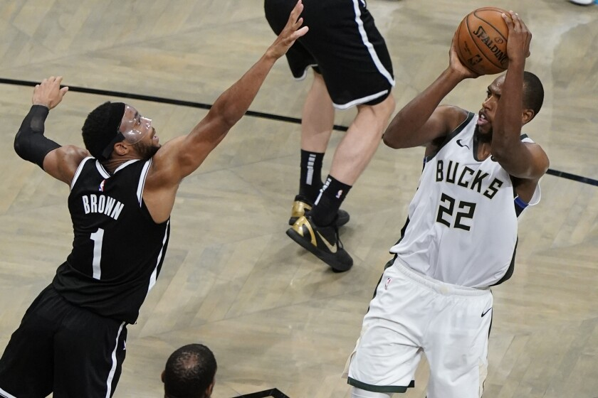 Milwaukee Bucks' Khris Middleton (22) shoots over Brooklyn Nets' Bruce Brown (1) during overtime of Game 7 of a second-round NBA basketball playoff series Saturday, June 19, 2021, in New York. (AP Photo/Frank Franklin II)