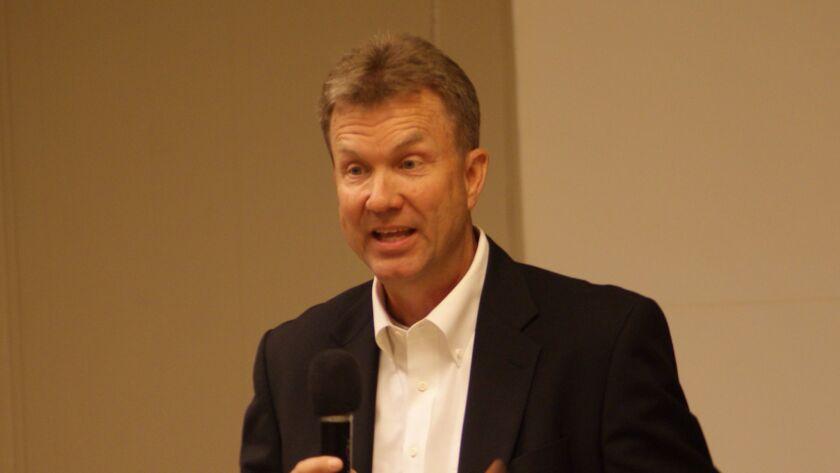 Newport Beach City Council candidate Scott Peotter talks to members of the Newport-Mesa Tea Party du