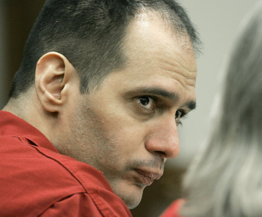 FILE - In this Tuesday, Jan. 9, 2007, file photo, death row inmate Juan Carlos Chavez is shown during the first day of hearings at a Miami-Dade County courtroom in Miami. Chavez is scheduled for execution by lethal injection at 6 p.m. Wednesday Feb. 12, 2014 at Florida State Prison in Starke, Fla. (AP Photo/Alan Diaz, File)