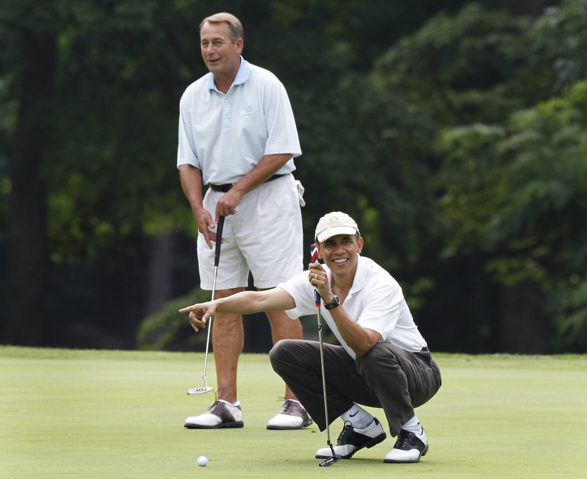 President Obama points to Vice President Joe Biden's putt as he and House Speaker John A. Boehner (R-Ohio) are on the first hole of their golf game at Andrews Air Force Base in Maryland.