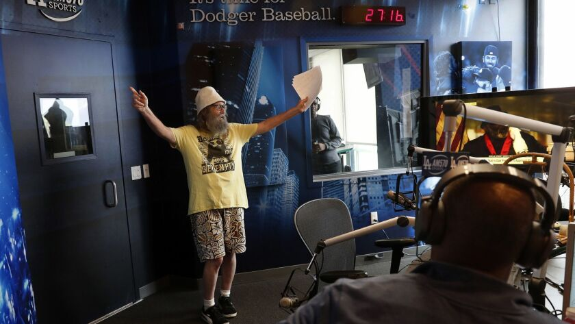 "BURBANK, CA-NOVEMBER 29, 2018: Radio sports announcer Vic ""The Brick"" Jacobs makes his entrance int"