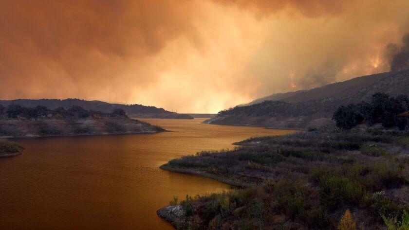 OJAI, CA - DECEMBER 5, 2017: Smoke from the Thomas Fire crosses over Lake Casitas in Ojai. (Michael