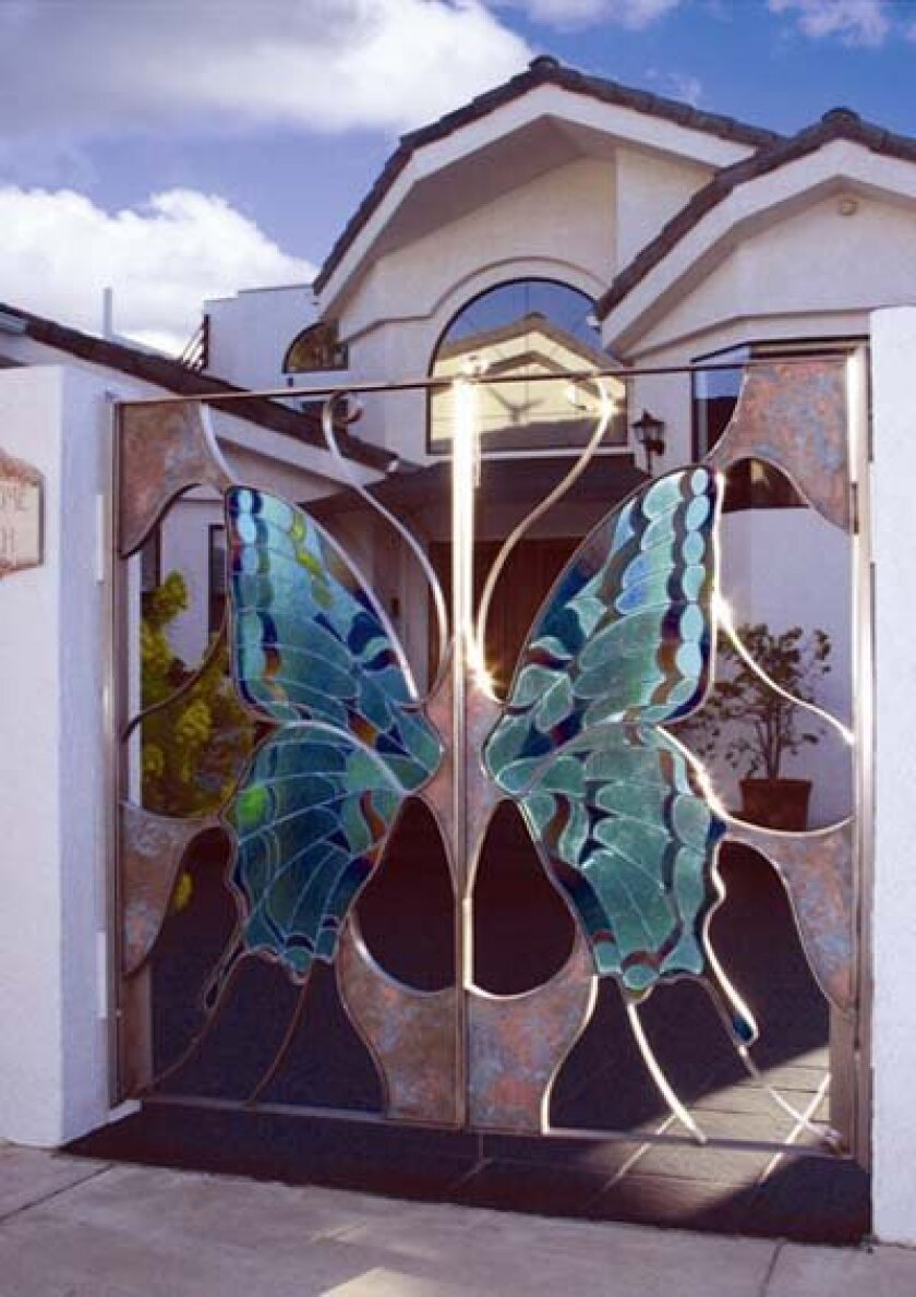 Fused Glass Wings by Vdirios Mundiales – Gate designed by artist Dale J. Evers. Photo: Courtesy