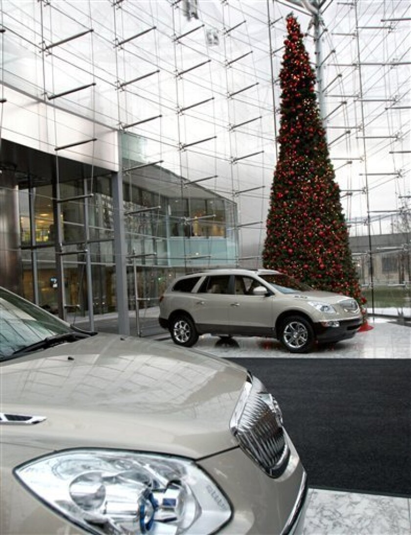 Two Buick Enclaves are seen in the lobby of the General Motors headquarters in downtown Detroit, Friday, Dec. 12, 2008. GM announced it will temporarily close 20 factories across North America and make sweeping cuts to its vehicle production as it tries to adjust to dramatically weaker automobile demand. (AP Photo/Carlos Osorio)