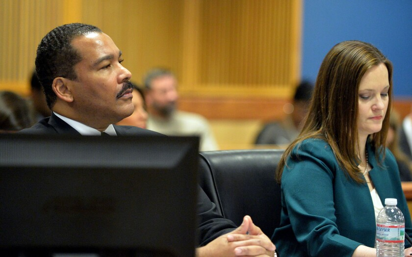 Dexter Scott King and attorney Nicole Wade at Tuesday's hearing in Fulton County Superior Court in Atlanta.