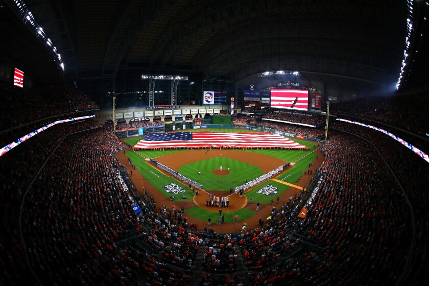 A giant American flag is held on the field as the national anthem is performed at Minute Maid Park.