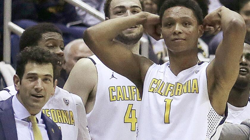 UC Berkeley assistant basketball coach Yann Hufnagel, left, is shown with players during a game against Oregon Feb. 11. School officials announced Monday that Hufnagel had been relieved of his duties in connection with sex harassment allegations.