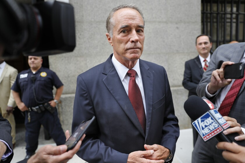 Rep. Chris Collins (R-N.Y.) speaks to reporters as he leaves the courthouse after a pretrial hearing in his insider trading case on Sept. 12 in New York.