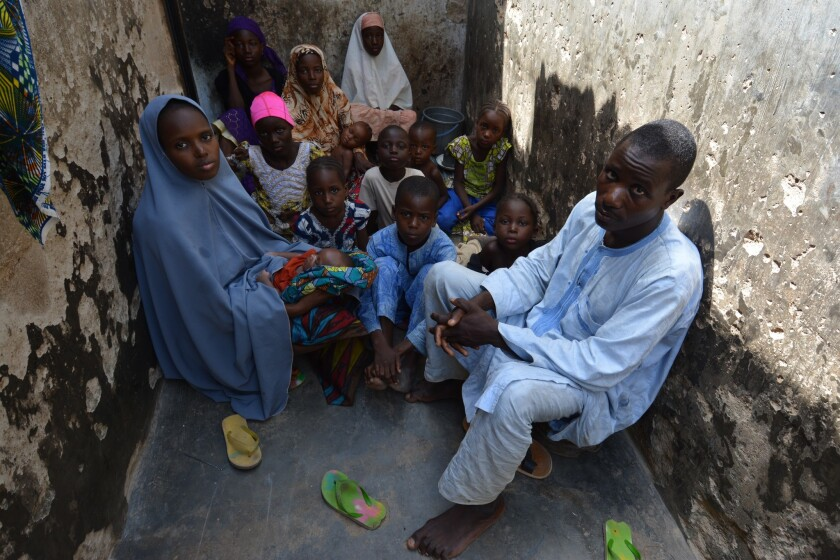Nigerian bricklayer Mohammed Umar can barely afford to provide for his four wives and 17 children. He rises each dawn to search for work and toils until late at night, but there is never enough food.