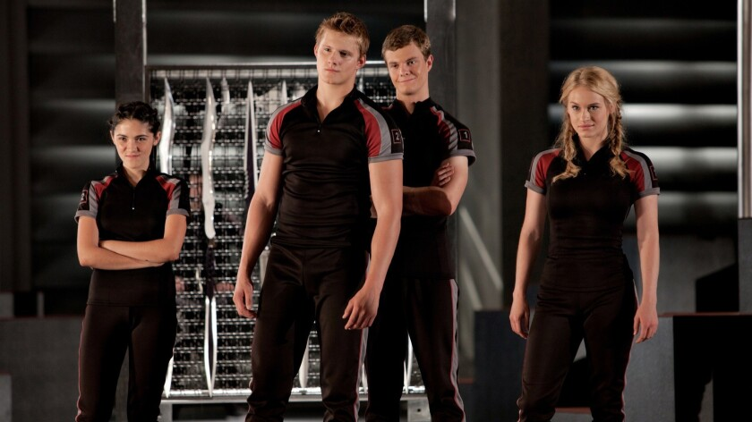 From left to right: Clove (Isabelle Fuhrman), Cato (Alexander Ludwig), Marvel (Jack Quaid) and Glimm