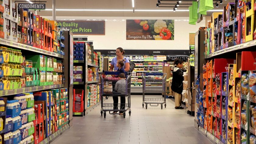 Customers make their way down one of the wide aisles at the new Aldi food store in Vista.