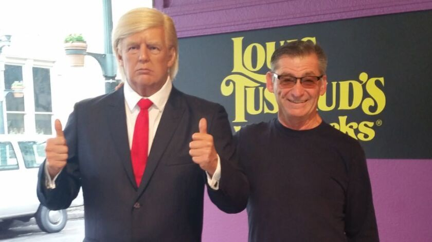 Kenneth Trump, of Escondido, shares the spotlight with a wax museum figure of President Donald Trump, no relation.