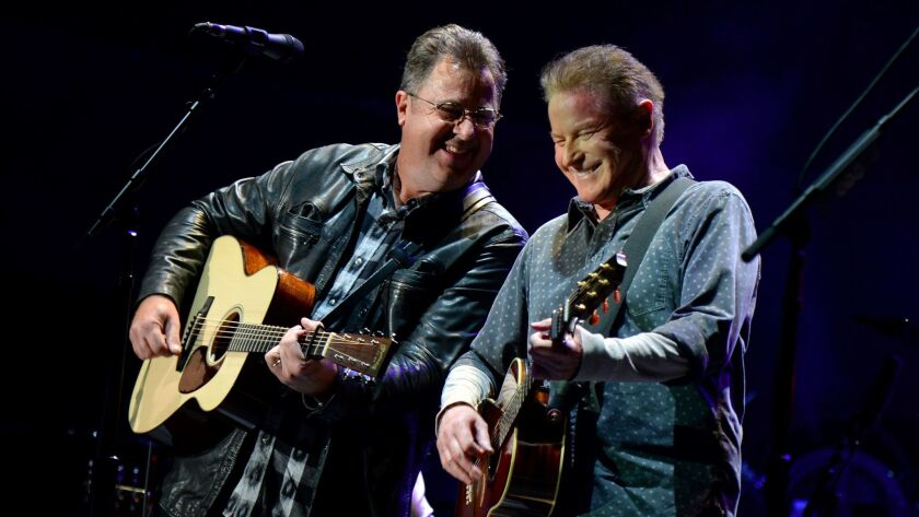 Vince Gill, left, joined Don Henley and the rest of the Eagles for Saturday's show.