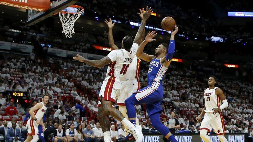 Philadelphia 76ers guard Ben Simmons (25) shoots in the first quarter as Miami Heat forward James Jo