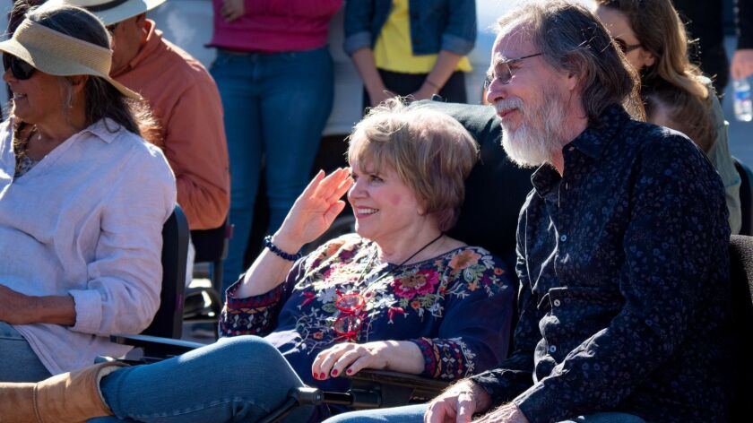 Linda Rondstadt and Jackson Browne watch the performances on a four-day visit to Banámichi, populati