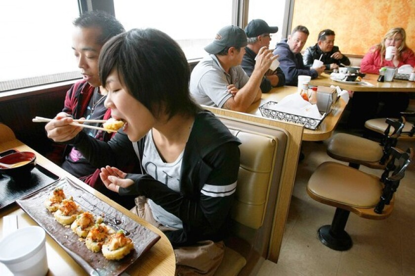Yumi Sugiyama of Sun Valley gets a King's Special: deep-fried eel, avocado, cream cheese and crab meat cut roll.