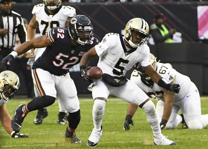 Chicago Bears defensive lineman Khalil Mack tries to tackle New Orleans Saints quarterback Teddy Bridgewater during Sunday's game.