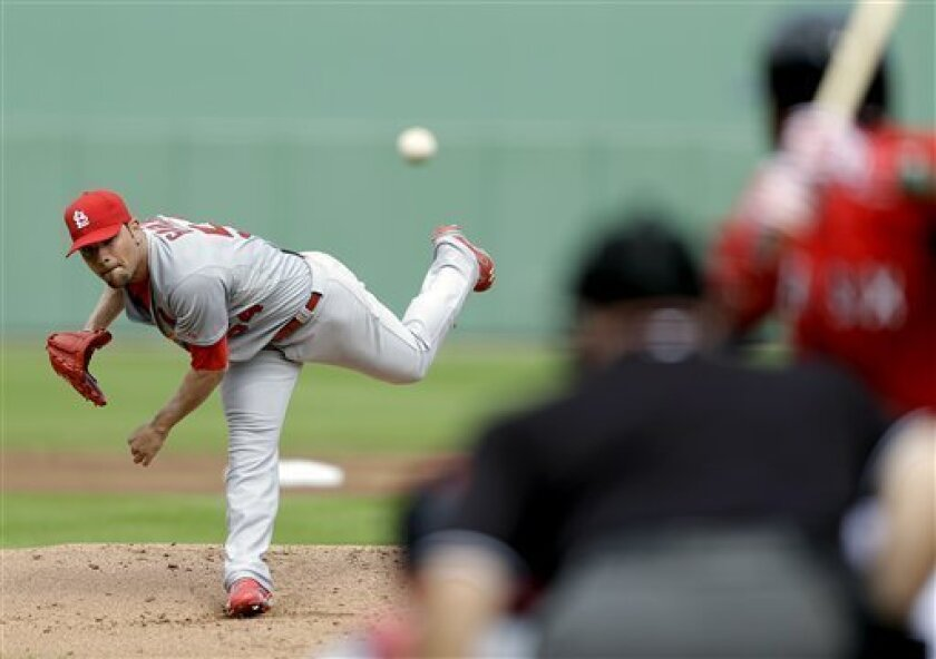 St. Louis Cardinals starting pitcher Jaime Garcia throws to Boston Red Sox's Jackie Bradley during the first inning of an exhibition spring training baseball game, Tuesday, Feb. 26, 2013, Fort Myers, Fla. (AP Photo/David Goldman)